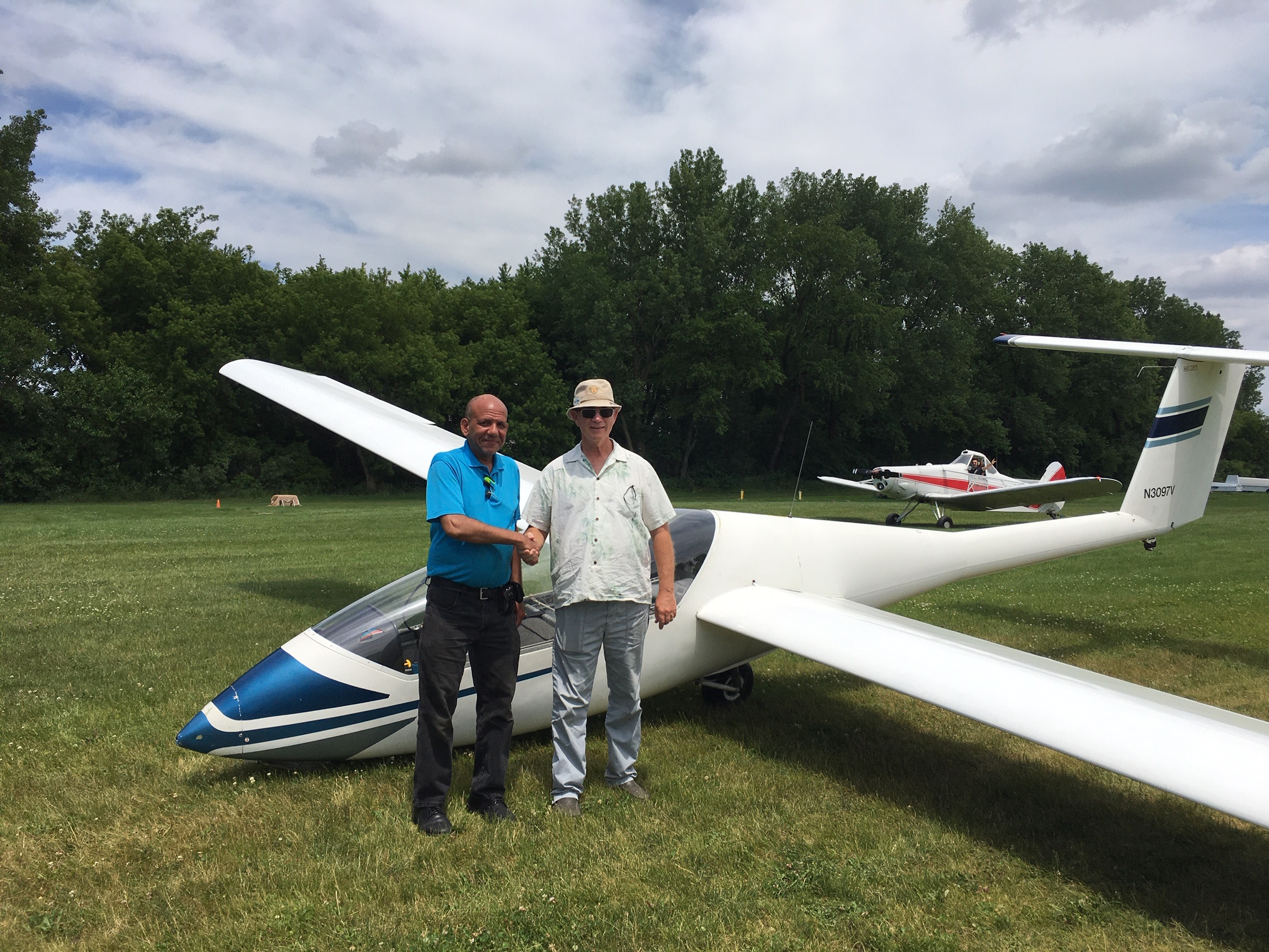 Steve Snyder congratulates Frank Smith on his solo flight with TowPilot Aaron in the background